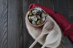 Quail eggs in red pot and kitchen tools. Healthy  food concept on wooden table Royalty Free Stock Photos