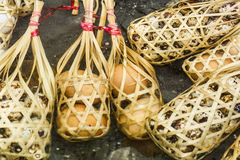 Quail eggs in round bamboo basket boil on hot spring Royalty Free Stock Photos