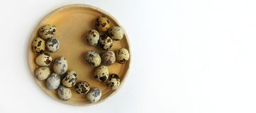 Quail eggs on a round beige ceramic plate . royalty free stock images