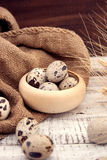 Quail eggs on rustic wooden background. Soft view Royalty Free Stock Images