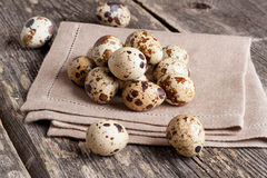 Quail eggs on rustic wooden table. Horizontal, close up Royalty Free Stock Photo