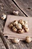 Quail eggs  on rustic wooden table. Quail eggs on rustic wooden table, vertical, close up Stock Image