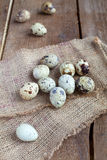 Quail Eggs on sacking and wooden table, rustic style Royalty Free Stock Photo