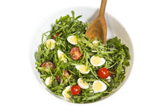 Quail eggs salad in a bowl with a wooden spoon Stock Photo