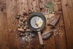 Quail eggs. Scrambled eggs with black bread on a wooden background royalty free stock photography