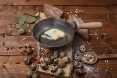 Quail eggs. Scrambled eggs with black bread on a wooden background stock photography