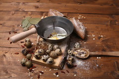 Quail eggs. Scrambled eggs with black bread on a wooden background stock images
