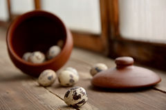 Quail eggs, selective focus. Quail eggs in a ceramic pot, one egg in focus Stock Photo