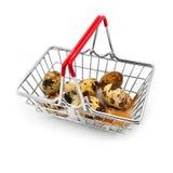 Quail eggs in a shopping cart Royalty Free Stock Photos