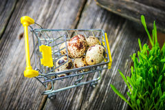 Quail eggs in shopping chart Royalty Free Stock Photography