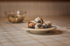 Quail eggs. Some contrast quail eggs on table Royalty Free Stock Photo