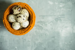 Quail eggs in textile basket on the rustic background Royalty Free Stock Photo