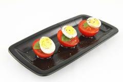 Quail eggs and tomatoes Stock Photo