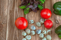 Quail eggs and vegetables. Quail eggs and vegetables and basil stock photography