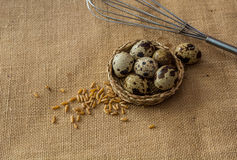 Quail eggs,wheat and eggbeater Royalty Free Stock Photo