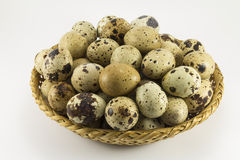 Quail eggs in a wicker oval shape Royalty Free Stock Image