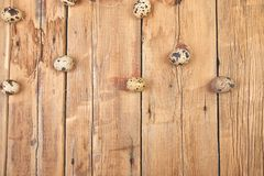 Quail eggs on wooden background. Happy easter royalty free stock photos