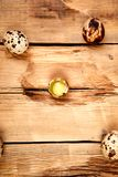 Quail eggs on wooden background. Happy easter stock images
