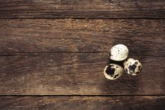 Quail eggs on wooden table. Quail eggs on wooden background, top view royalty free stock photos