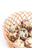 Quail eggs in the wooden basket Royalty Free Stock Image