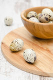 Quail eggs on a wooden board, selective focus Royalty Free Stock Images