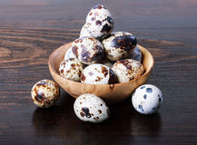 Quail eggs in a wooden bowl Royalty Free Stock Photography