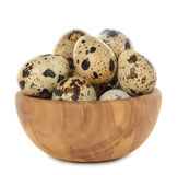 Quail eggs in a wooden bowl. Isolated on white background Stock Photo