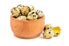 Quail eggs in a wooden bowl Royalty Free Stock Photo