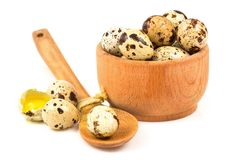 Quail eggs in a wooden bowl and spoon Royalty Free Stock Photo