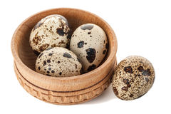 Quail eggs in wooden plate isolated on white background. Quail eggs in wooden plate isolated over white background Royalty Free Stock Image