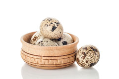Quail eggs in wooden plate isolated on white background. Quail eggs in wooden plate isolated over white background Stock Photography