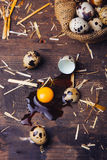 Quail eggs on wooden table. Quail eggs on a brown wooden table Royalty Free Stock Images