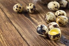Quail eggs on a wooden table stock photography
