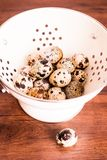 Quail eggs on a wooden vintage table, selective focus. Healthy and organic food option. Easter food. Easter symbol. Quail eggs on a wooden vintage table stock photos