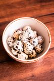 Quail eggs on a wooden vintage table, selective focus. Healthy and organic food option. Easter food. Easter symbol. Quail eggs on a wooden vintage table royalty free stock images