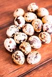 Quail eggs on a wooden vintage table, selective focus. Healthy and organic food option. Easter food. royalty free stock image