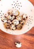 Quail eggs on a wooden vintage table, selective focus. Healthy and organic food option. Easter food. Easter symbol. Quail eggs on a wooden vintage table stock photography