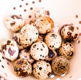 Quail eggs on a wooden vintage table, selective focus. Healthy and organic food option. Easter food. Easter symbol. Quail eggs on a wooden vintage table royalty free stock image