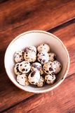 Quail eggs on a wooden vintage table, selective focus. Healthy and organic food option. Easter food. Easter symbol. Quail eggs on a wooden vintage table royalty free stock photo