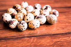 Quail eggs on a wooden vintage table, selective focus. Healthy and organic food option. Easter food. Easter symbol. Quail eggs on a wooden vintage table stock photo