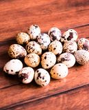 Quail eggs on a wooden vintage table, selective focus. Healthy and organic food option. Easter food. stock image