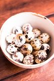 Quail eggs on a wooden vintage table, selective focus. Healthy and organic food option. Easter food. stock photo