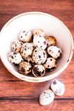 Quail eggs on a wooden vintage table, selective focus. Healthy and organic food option. Easter food. royalty free stock images
