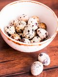Quail eggs on a wooden vintage table, selective focus. Healthy and organic food option. Easter food. stock images