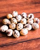 Quail eggs on a wooden vintage table, selective focus. Healthy and organic food option. Easter food. royalty free stock photos