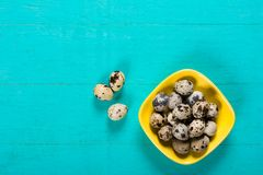 Quail eggs in bowl on wooden background royalty free stock images