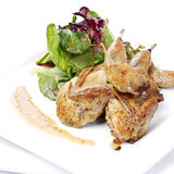 Quail with green salad Royalty Free Stock Images