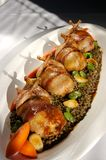 Quails. Wrap in beacon with carrots and Lentils served buffet style Royalty Free Stock Photo