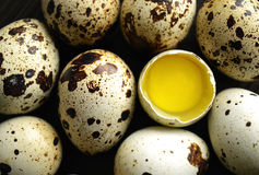 The quails eggs. The quail eggs in a brown bowl on wooden surface Stock Photo