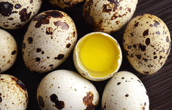 The quails eggs. The quail eggs in a brown bowl on wooden surface Stock Images